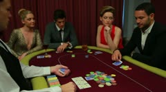Four people playing poker and one going all in - stock footage