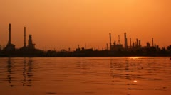 River and oil refinery factory with reflection in Bangkok, Thailand. Stock Footage