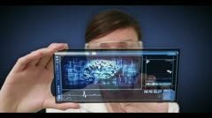 Doctor scrolling through medical interface wth copyspace Stock Footage