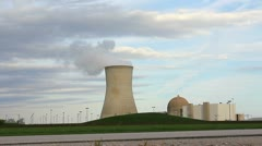 Nuclear power plant with reactor - cooling tower with steam - stock footage