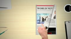 Hand turning pages of world news business magazine Stock Footage