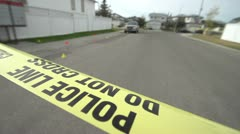 Crime and justice, crime scene tape and evidence markers, wide Stock Footage