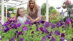 Mother and child at the garden centre Stock Footage