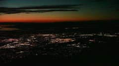 Pan L at Night / Twilight across Great Salt Lake and Lights of Utah Cities Stock Footage