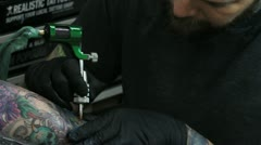 Man tattooing an arm Stock Footage
