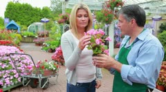 Employee showing a plant to customer Stock Footage