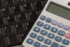 Calculator and laptop Stock Photos