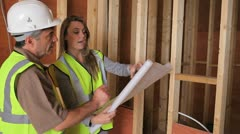 Architect discussing plan with builder - stock footage
