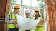 Architects discussing the construction - stock footage