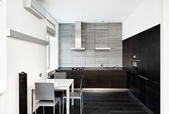 Modern minimalism style kitchen interior in monochrome tones Stock Photos
