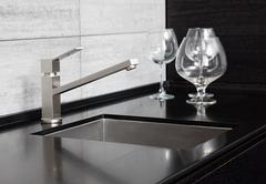 Modern kitchen sink with metal tap and black marble Stock Photos