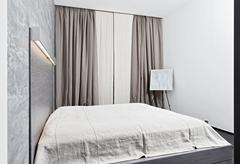 Modern minimalism style bedroom interior in monochrome tones Stock Photos