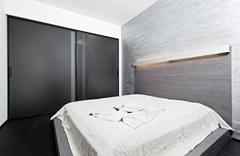 Modern minimalism style bedroom interior in beige tones Stock Photos