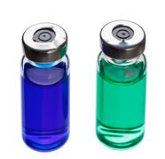 blue and green medical ampoules isolated on a white - stock photo