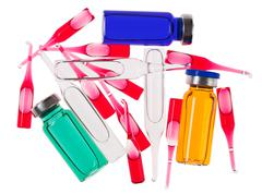 multicolor medical ampoules isolated on a white - stock photo