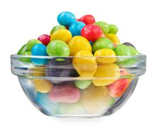 multicolor bonbon sweets (ball candies) in glass bowl, isolated on white - stock photo