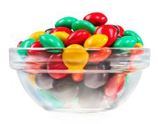 Stock Photo of multicolor bonbon sweets (ball candies) in glass bowl, isolated on white