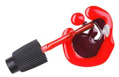 red nail polish (enamel) drops with brush, isolated on white - stock photo