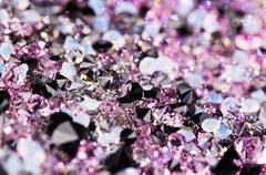 small purple gem stones, luxury background shallow depth of field - stock photo
