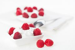 still life with raspberry sour cream dessert on white linen table cloth, copy - stock photo