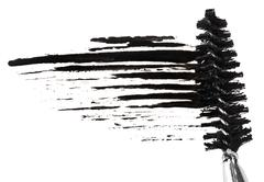 stroke of black mascara with applicator brush, isolated on white macro - stock photo