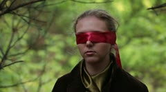 Woman with red blindfold Stock Footage