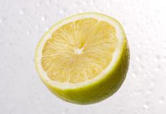 lemon on dewy background - stock photo