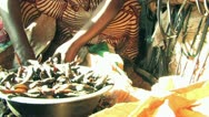 Woman Sells Fish at African Market Stock Footage