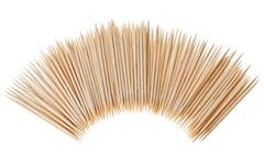 many scattered toothpicks in semicircle shape - stock photo