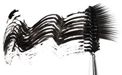 Black mascara stroke, brush and false eyelashes abstract composition, on whit Stock Photos