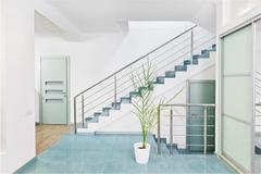 Part of modern hall interior with metal staircase in minimalism style Stock Photos