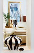 Part of modern art deco style drawing-room interior with striped vase Stock Photos