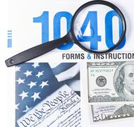 Money and taxes Stock Photos