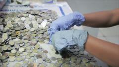 Counting Money for charity Stock Footage