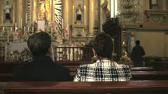 People Praying in church Stock Footage