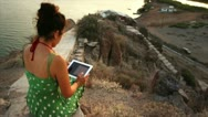 Woman on Promontory with Tablet Stock Footage
