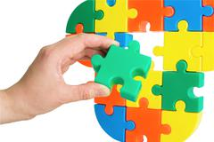 Hand with color puzzle Stock Photos