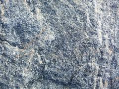 surface of a uneven granite - stock photo