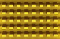 macro-photo of golden metal radiator - stock photo