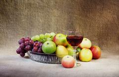 Classical still-life with fruit and glass Stock Photos