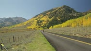 Aspen Fall Foliage with Cyclists Stock Footage