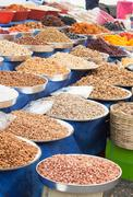 Dried fruit and nuts in market - stock photo