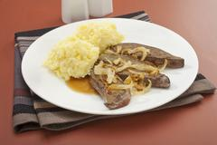 Liver and onion with mash mashed potato Stock Photos