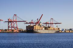 Container ship at loading wharf Stock Photos