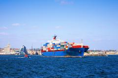 Container ship leaving fremantle port western australia Stock Photos