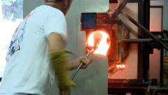 Reheating glass in glory hole Stock Footage