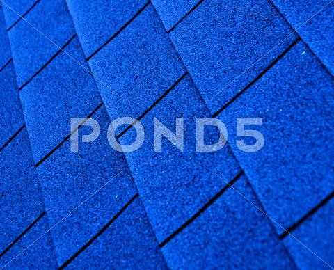 Stock photo of blue shingle roofing