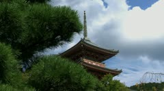 Slide clouds timelapse from tree to the pagoda of the Kiyomizu temple Stock Footage