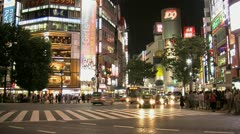 Timelapse from crowded intersection outside Shibuya Station in the evening Stock Footage