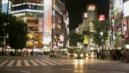 Stock Video Footage of Timelapse from crowded intersection outside Shibuya Station in the evening